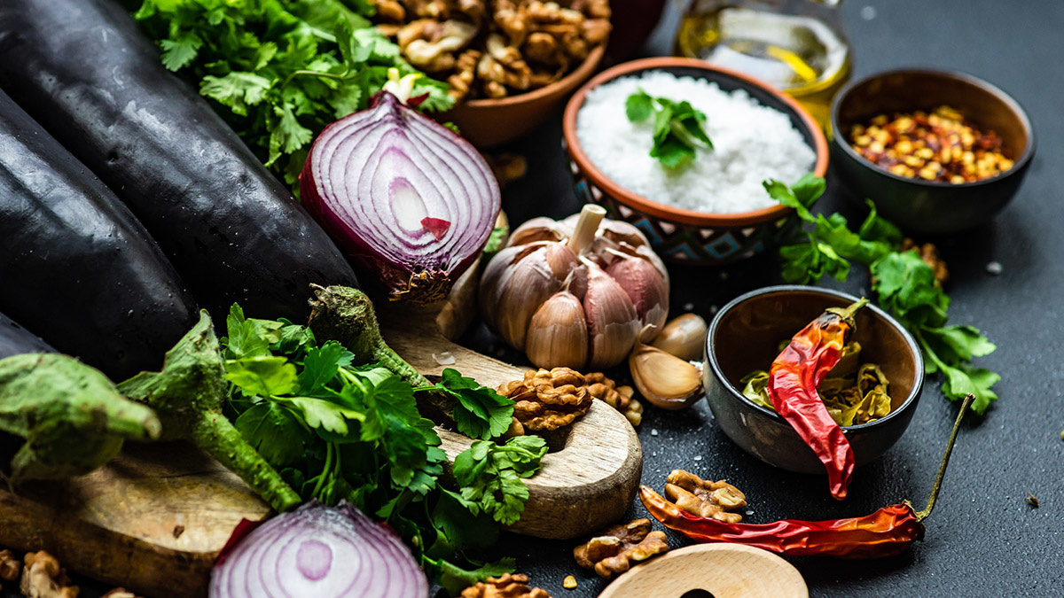 Ingredients for cooking eggplant with nut pasta on rustic background